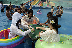 August 2, 2017 - Chongqing, Chongqing, China - Chongqing, CHINA- August 2 (EDITORIAL USE ONLY. CHINA OUT) ..Citizens play mahjong at a pool in southwest China's Chongqing, August 2nd, 2017. The heatwave pushes the temperature above 40 Celsius degree in Chongqing, (Credit Image: © SIPA Asia via ZUMA Wire)
