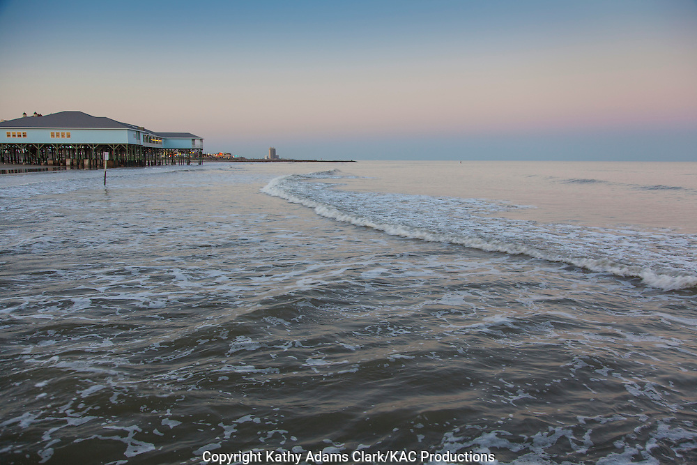 Waves coming in, late afternoon, Galveston, Texas, coast. The Earth's shadow is visible on the horizon and the Belt of Venus or anti-twilight is the pink area above.