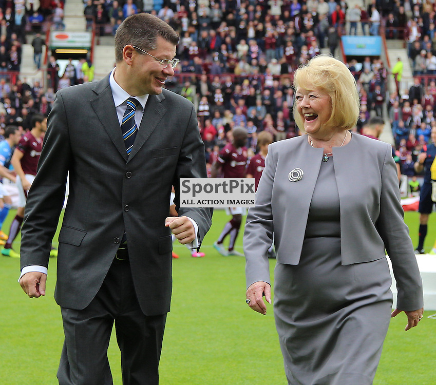 Hearts v St Johnstone Scottish Premiership 2 August 2015; Hearts owner, Ann Budge, and Neil Doncaster unveil the Championship flag before the Heart of Midlothian v St Johnstone Scottish Premiership match played at Tynecastle Stadium, Edinburgh; <br /> <br /> &copy; Chris McCluskie | SportPix.org.uk
