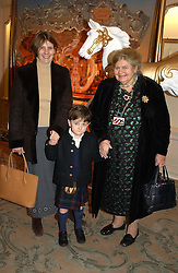 Left to right, CATHERINE HERDMAN, her son ALFRED HERDMAN and her mother BARONESS STRANGE at a children's party in aid of the charity Over The Wall held at Fortnum & Mason, Piccadilly, London before a gala premiere of the new musical Mary Poppins at The Prince of Wales Theatre, Old Compton Street, London W1<br /><br />NON EXCLUSIVE - WORLD RIGHTS