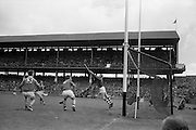 04/09/1966<br /> 09/04/1966<br /> 4 September 1966<br /> All-Ireland Minor Hurling Final: Cork v Wexford at Croke Park, Dublin.<br /> Cork's F. Norberg (right) scores a goal.