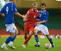 CARDIFF, WALES - Friday, September 5, 2008: Wales' David Edwards and Azerbaijan's Nodar Mamedov during the opening 2010 FIFA World Cup South Africa Qualifying Group 4 match at the Millennium Stadium. (Photo by Gareth Davies/Propaganda)
