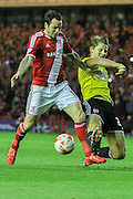 Toumani Diagouraga tackles Lee Tomlin during the Sky Bet Championship Play Off Second Leg match between Middlesbrough and Brentford at the Riverside Stadium, Middlesbrough, England on 15 May 2015. Photo by Simon Davies.