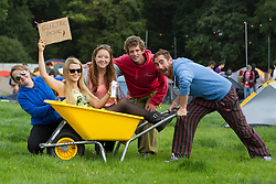 Louise Kennedy, Sinead Kealy and Claire Kennedy from Offaly are pictured with Ryan Vekins and Gorden Ellerker from Clare setting up camp on the first day of Electric Picnic 2013. Picture Andres Poveda
