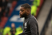 Olivier Ntcham of Celtic FC during the warm up ahead of the Betfred Scottish League Cup Final match between Rangers and Celtic at Hampden Park, Glasgow, United Kingdom on 8 December 2019.