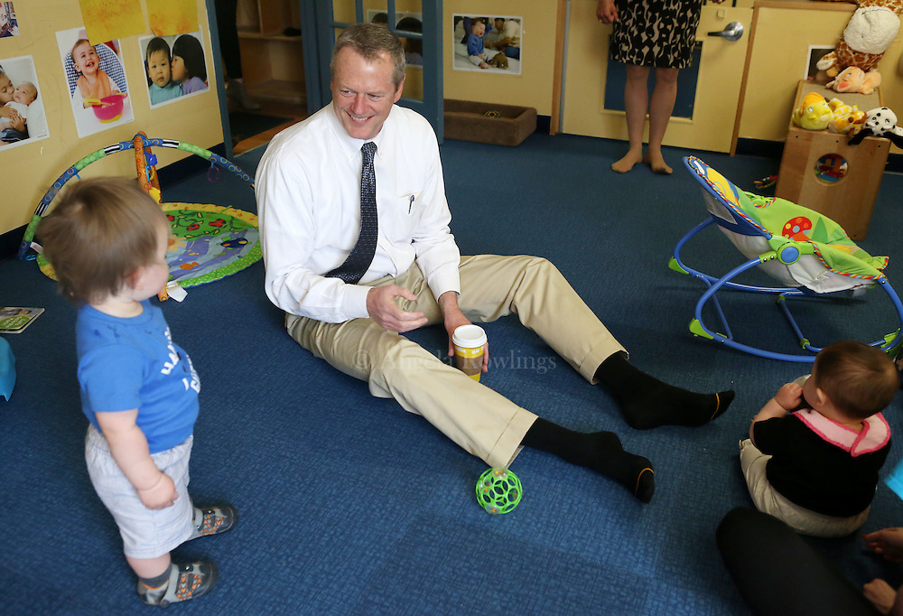 (Boston, MA - 5/26/15) Gov. Charlie Baker interacts with the children in the Infant Room at the Boys & Girls Club in Dorchester, Tuesday, May 26, 2015. Staff photo by Angela Rowlings.