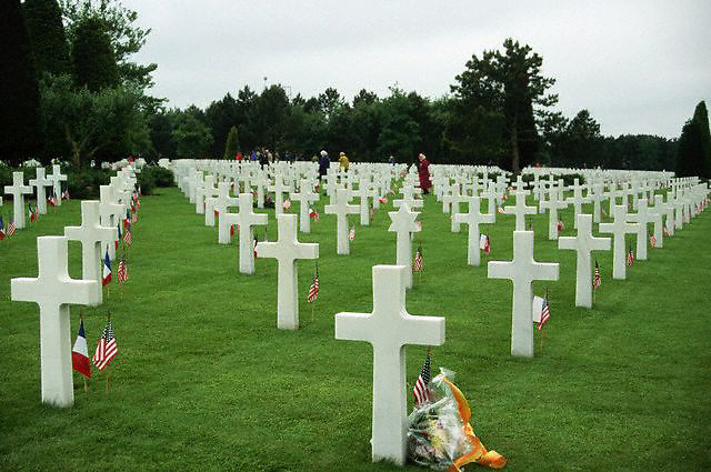 June 5-6, 1994, Colleville-sur-Mer, France --- Small American flags stand next to white crosses at the Normandy American Cemetery, on the 50th anniversary of the Normandy invasion. --- Image by © Owen Franken/Corbis