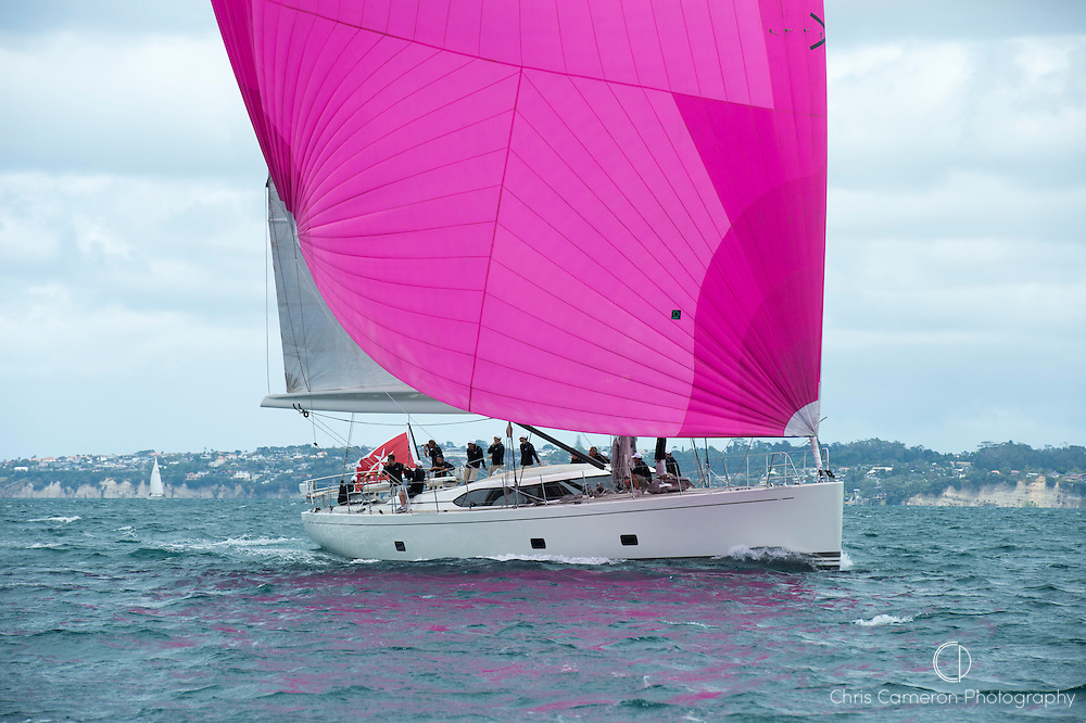 Unknow white yacht with Pink Spinnaker and Malteses flag sailing on the Hauraki Gulf.