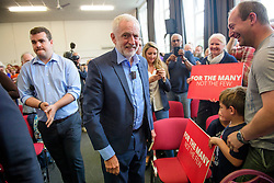 © Licensed to London News Pictures. 07/08/2017. Crawley, UK. Labour Party leader JEREMY COBYN is greeted by supporters and party members during a campaign visit in Crawley, Surrey. Corbyn has faced recent criticisms for his response to the crisis in Venezuela, a country ruled by a government he has openly backed in the past.  Photo credit: Ben Cawthra/LNP