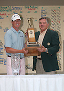 Michael Harris from Milwaukee, Wisconsin (left) is all smiles as he accepts the Walter Hagen Trophy from former Michigan PGA President Bill Rogers (right) after winning the 2006 Tournament of Champions at Boyne Mountain.