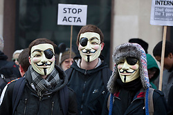 © licensed to London News Pictures. London, UK 11/02/2012. Protesters wearing eye badges on their Guy Fawkes masks at the demonstration against the anti-privacy law ACTA, outside British Music House in central London. Photo credit: Tolga Akmen/LNP