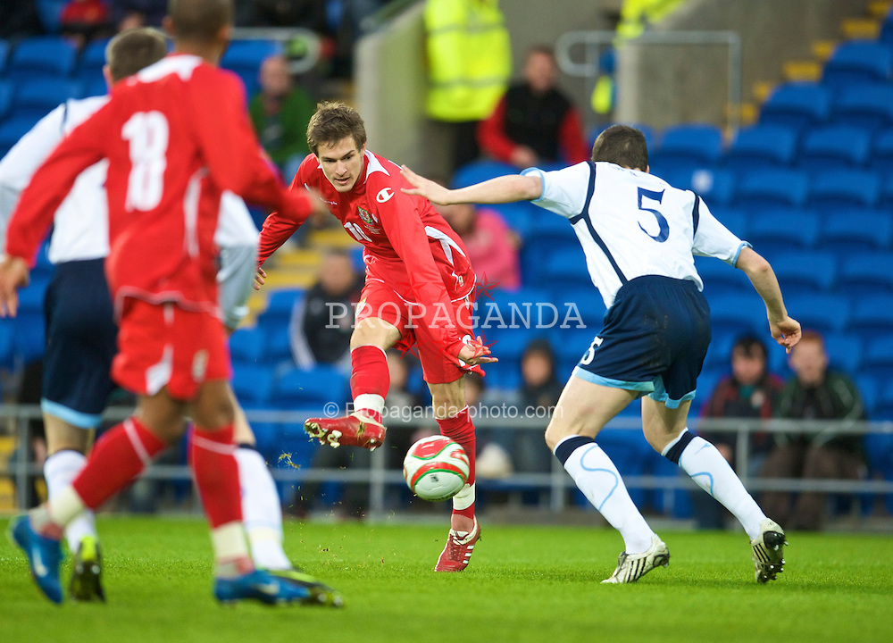 CARDIFF, WALES - Saturday, November 14, 2009: Wales' Aaron Ramsey in action against Scotland during the international friendly match at the Cardiff City Stadium. (Pic by David Rawcliffe/Propaganda)