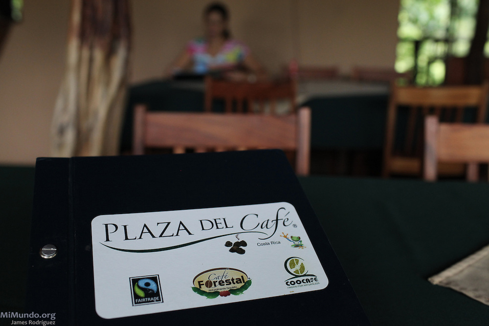 A customer awaits to be served in COOCAFE's Plaza del Café Restaurant near the Arenal Volcano. COOCAFE, Tilarán, Guanacaste, Costa Rica. August 22, 2012.