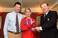 Admiral  Royal Cork  John Roche presenting Rob Keal with 3rd place overall prize at the Topper Winter Championships.