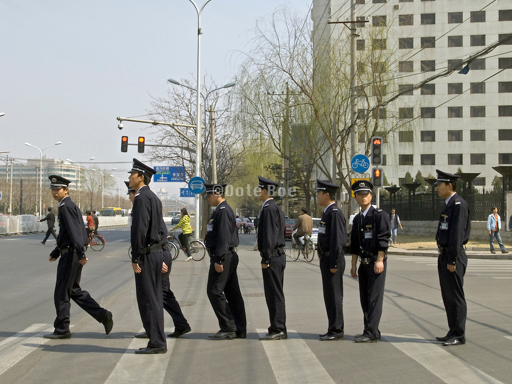 group of police officers marching China Beijing