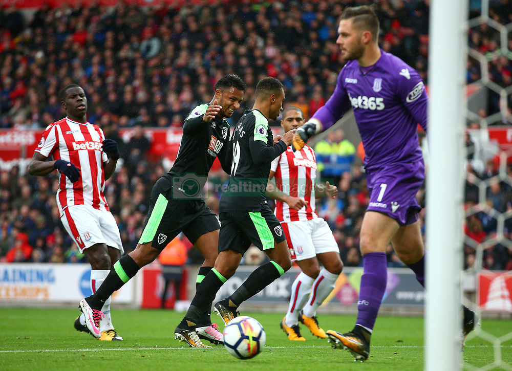 AFC Bournemouth's Junior Stanislas (centre) celebrates scoring his side's first goal from the penalty spot during the Premier League match at the bet365 Stadium, Stoke-on-Trent.
