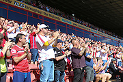 On the 21st Minute, Walsall Fans clap for 1 minute in respect of Saddlers Fan Joel Richards who died in the Tunisian Terror Attacks, and would have been 21 on Friday 05th August during the EFL Sky Bet League 1 match between Walsall and AFC Wimbledon at the Banks's Stadium, Walsall, England on 6 August 2016. Photo by Stuart Butcher.