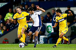 Claudio Yacob of West Brom is challenged by Alfie Potter of Oxford United - Photo mandatory by-line: Rogan Thomson/JMP - 07966 386802 - 26/08/2014 - SPORT - FOOTBALL - The Hawthorns, West Bromwich - West Bromwich Albion v Oxford United - Capital One Cup Round 2.
