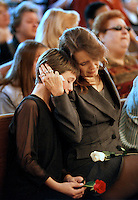Marsha Lanier, right, and her daughter Neesha Lanier confort each other, Sunday Oct. 24, 1999, during the tribute service of Marsha's father, Rev. Ed Sheriff, inside the church he was the pastor. Rev. Sheriff, a gay rights advocate and associate Pastor of the Cathedral of Promise Metropolitan Church in Sacramento, was found stabbed to death in his home Wed, Oct. 20, 1999.