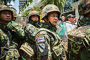 25 MAY 2014 - BANGKOK, THAILAND:  Thai soldiers on duty during a demonstration against the military junta. Public opposition to the military coup in Thailand grew Sunday with thousands of protestors gathering at locations throughout Bangkok to call for a return of civilian rule and end to the military junta.    PHOTO BY JACK KURTZ