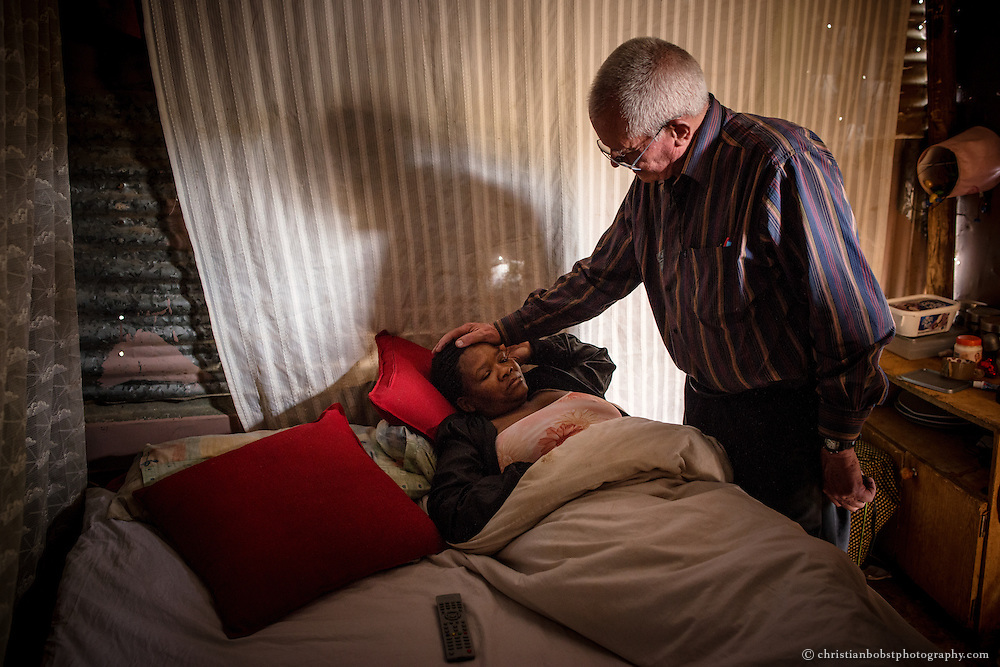 (2013) Father Hermann visits a sick woman at her room in Damara 6.