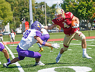 Coe's Trevor Heitland (4) fends off Loras's Alex Wernimont in the first quarter at a college football game with Loras College at Coe College Stadium in Cedar Rapids on Saturday, Sept. 17, 2016. Coe won the game 45-10. (Rebecca F. Miller/The Gazette)