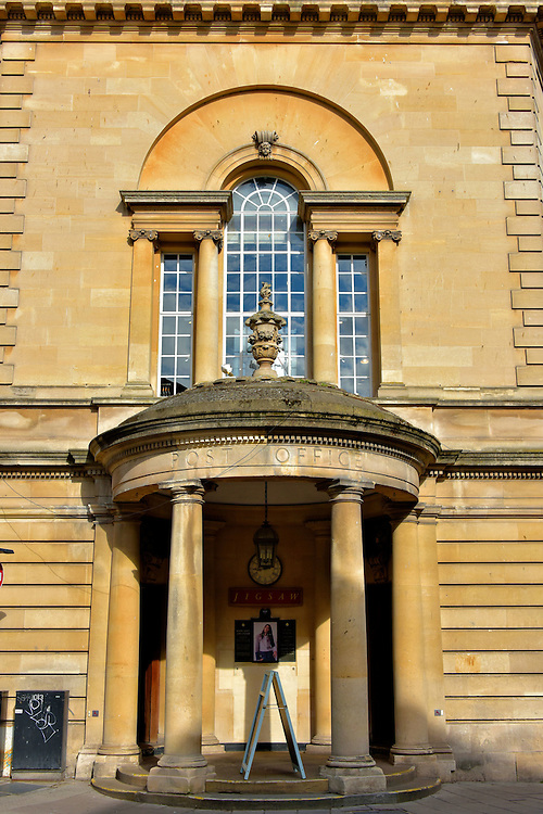 Old Post Office in Bath, England<br /> This semi-circular entrance on New Bond Street served Bath&rsquo;s Post Office from 1822 &ndash; 1854.  It is a great example of skillfully repurposing architecture.  The beauty of its neoclassical fa&ccedil;ade has been preserved.  Inside it was transformed into a bright and airy shopping space as modern as the designer fashions sold by retailer Jigsaw. If you would like to learn many fascinating facts and stories about the English postal system, take time to visit the nearby Bath Postal Museum on Green Street.