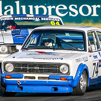 David Bartlett (74 - Ford Escort MKII) leads Glen Brocklehurst (64 - Ford Falcon) onto the main straight at Wanneroo Raceway