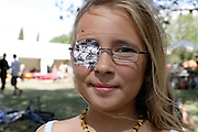 portrait of a young girl with eye patch and wearing glasses