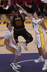 March 11, 2018 - Los Angeles, California, U.S - LeBron James #23 of the Cleveland Cavaliers drives between Lonzo Ball #2 and Kyle Kuzma #0 of the Los Angeles Lakers during their NBA game on Sunday March 11, 2018 at the Staples Center in Los Angeles, California. Lakers defeat Cavaliers, 127-113. (Credit Image: © Prensa Internacional via ZUMA Wire)