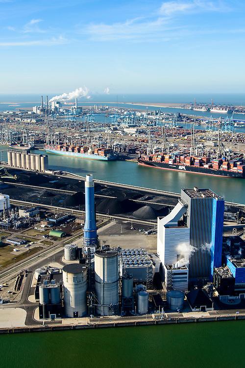 Nederland, Zuid-Holland, Rotterdam, 18-02-2015; Eerste Maasvlakte met aan de Mississippihaven Europees Massagoed Overslagbedrijf (EMO). In de voorgrond de Centrale Electrabel (GDF SUEZ), verstookt biomassa en steenkool. De brandstof komt van het EMO. Links van centrale de  Peakshaver van de Nederlandse Gasunie (installatie voor Liquefied Natural Gas LNG). Op het tweede plan APM Terminals.<br /> First Maasvlakte with the Mississippi harbour and European Massagoed Overslagbedrijf (EMO), dry bulk transhipment terminal. In the foreground the  Electrabel power plant (GDF SUEZ), biomass and coal. Next to the power plant installation for Liquefied Natural Gas LNG). <br /> luchtfoto (toeslag op standard tarieven);<br /> aerial photo (additional fee required);<br /> copyright foto/photo Siebe Swart