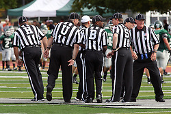 17 September 2011: Head linesman Josh Reese, umpire Jeff Conrad, Referee Scott Curtis, Back Judge Bryan Banks, Side Judge Steve Mitze, Line Judge Ray McCormick and Field Judge John Rigg during an NCAA Division 3 football game between the Aurora Spartans and the Illinois Wesleyan Titans on Wilder Field inside Tucci Stadium in.Bloomington Illinois.