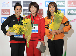 © Licensed to London News Pictures. London, UK. 27/04/2014. London, UK.  Women's winners Canadian BENFEITO Meaghan,left, Chinese CHEN Ruolin, and PAMG PANDELA Rinong at the FINA Diving World Series final at the Aquatics Centre, Queen Elizabeth Olympic Park. Photo credit: LNP
