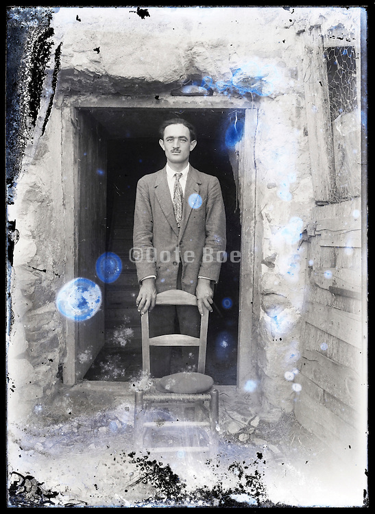 eroding glass plate photo of ale person in door opening