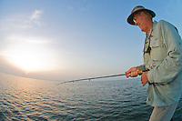 Fly fisherman hooks a big catch in the Laguna Madre off the Texas Gulf Coast.