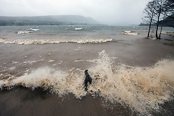© Licensed to London News Pictures. 26/01/2016. Ullswater UK. The high winds from Storm Jonas have made the normally peaceful lake of Ullswater more of a sea with waves crashing against the shoreline. Photo credit: Andrew McCaren/LNP