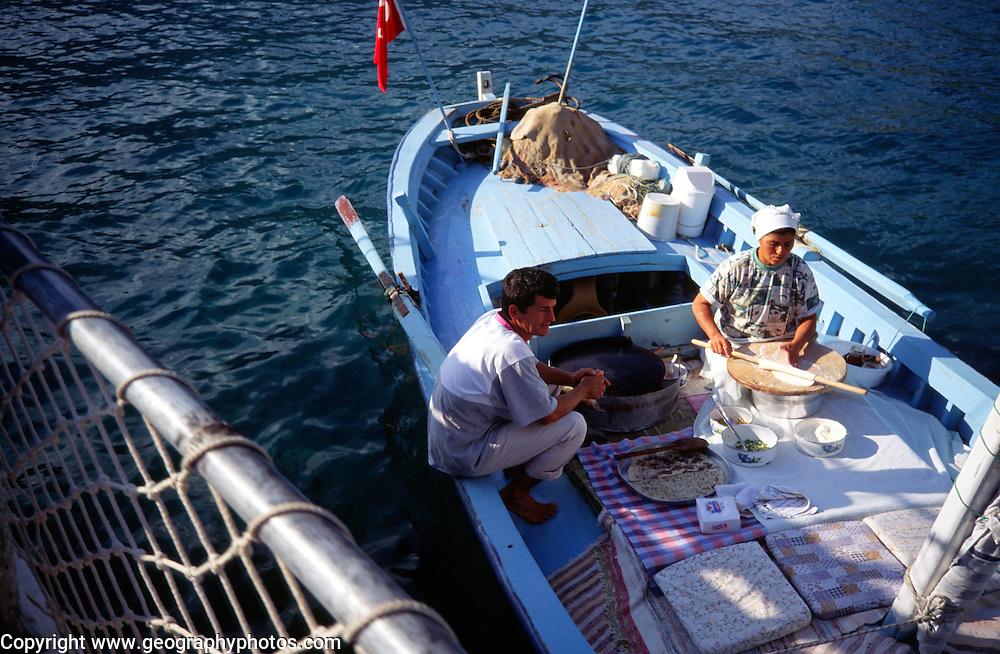 Small boat making pancakes for tourists, Fethiye, Turkey