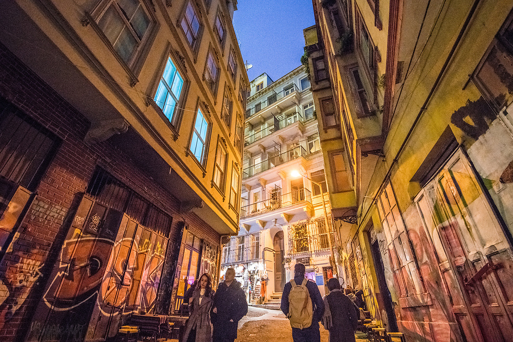 Low angle view of a tight alleyway in between buildings in the city of Istanbul, Turkey