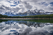 Peaks of the Bow Range reflect in Herbert Lake, Canadian Rockies, Banff National Park, Alberta, Canada. Banff National Park is Canada's oldest national park, established in 1885, and is part of the Canadian Rocky Mountain Parks World Heritage Site declared by UNESCO in 1984.