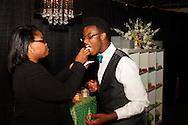 Lyric Fields (left) feeds brother James Fields IV a Caramel Apple mini Pi dessert from Elite Catering in the piano and champagne lounge during the 2013 Boonshoft Gala at the Boonshoft Museum of Discovery in Dayton.  The theme, Hip to be Square, is reflected in xhibits and demonstrations during the evening.
