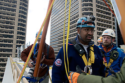 21 stories above ground level in Center City, Philadelphia, PA, USA - November 2, 2012; ..As they make the step over the edge rappellers have to overcome fair and rappel down more than 230ft. ..The participants first train at a one story instruction drop before heading for the big one. ..Philadelphia Mayor Michael Nutter is one of 'Fearless Rappellers'. Almost 70 attended the fundraising event, organized by Outward Bound Philadelphia and Over the Edge...Mayor Michael Nutter listens the instructers before rappelling down.