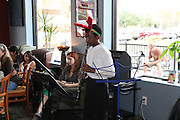 Grady Middle School Band student Tesla Alford performs as part of Ms. Plunkett's Holiday Studio Concert at Bean's Cafe. All of the students played to a full house under the direction of Mr. Leif Hall.<br />