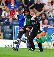 Photo: Leigh Quinnell.<br /> Wycombe Wanderers v Shrewsbury. Coca Cola League 2. 22/09/2007. Wycombe goalkeeper Jamie Young is carried from the pitch after an injury.