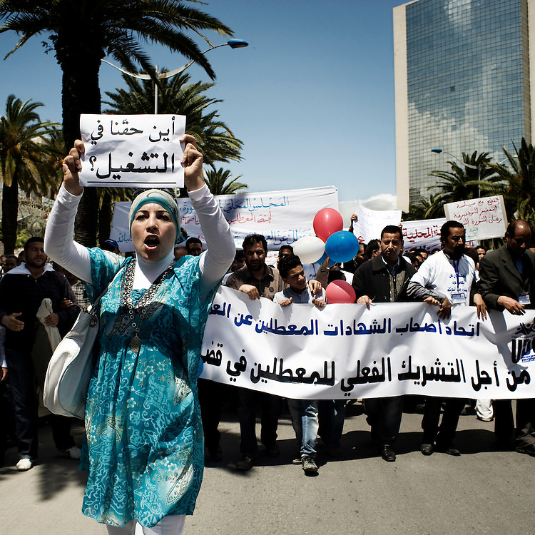 First of May. A girl of UDC movement (Union De Chomeurs) protests passionately against the high rates of unemployment. .In 2011 in Tunis 3.000 people are receiving unemployment benefits.