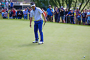 Korean golf professional Y E Yang  just misses with his putt during the BMW PGA Championship at the Wentworth Club, Virginia Water, United Kingdom on 28 May 2016. Photo by Simon Davies.