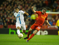 21.02.2013, Anfield, Liverpool, ENG, UEFA Europa League, FC Liverpool vs Zenit St. Petersburg, im Bild Liverpool's Jamie Carragher makes a mistake to let in FC Zenit St Petersburg's Givanildo Vieira de Souza 'Hulk' for the opening goal during UEFA Europa League match between Liverpool FC and Zenit St. Petersburg at Anfield, Liverpool, Great Britain on 2013/02/21. EXPA Pictures © 2013, PhotoCredit: EXPA/ Propagandaphoto/ David Rawcliffe..***** ATTENTION - OUT OF ENG, GBR, UK *****