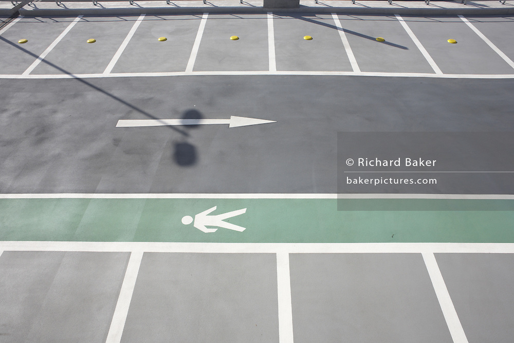 Unused car parking bays and arrow outside newly-opened London Heathrow Airport's Terminal 5 building.