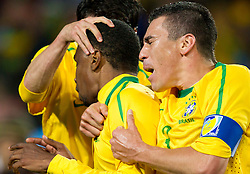 Juan of Brazil and Lucio of Brazil celebrate after Juan scored during the 2010 FIFA World Cup South Africa Round of Sixteen match between Brazil and Chile at Ellis Park Stadium on June 28, 2010 in Johannesburg, South Africa.  (Photo by Vid Ponikvar / Sportida)