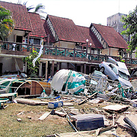 Bed Sheet Escape Over Pile of Cars After Tsunami on Patong Beach in Phuket, Thailand <br />