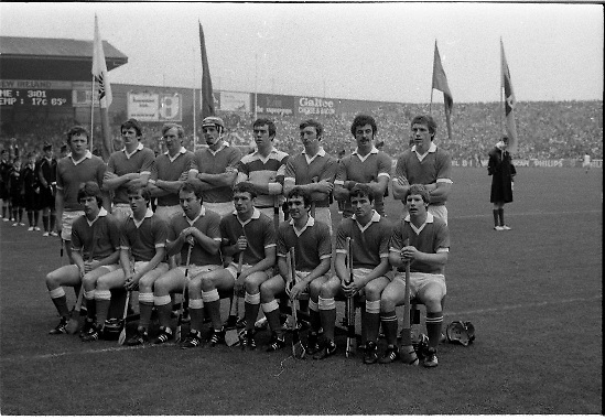 All Ireland Hurling Final - Cork vs Kilkenny.05.09.1982.09.05.1982.5th September 1982.Photographs taken at the final In Croke Park, Dublin. Kilkenny were the winners with a score of 3.18 to 1.7 for Cork..Here Cork pose for the traditional team photograph. In the background is the Artane Boys Band